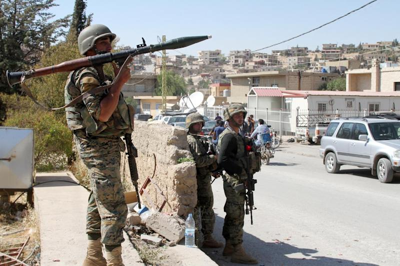 Lebanese troops stand guard in a street in the eastern town of Arsal, on the border with Syria, on August 9, 2014, a day after the Lebanese army began deploying into the town