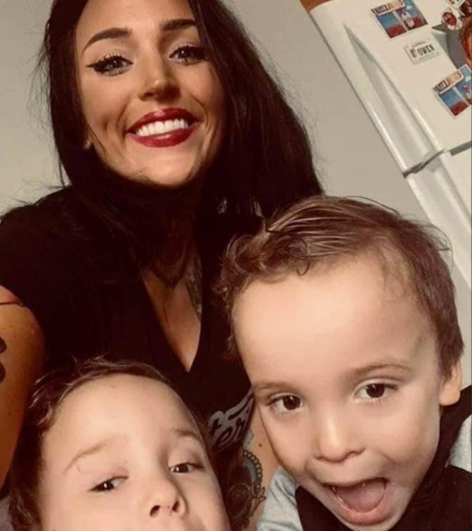 The mum and twins smiling in a selfie.