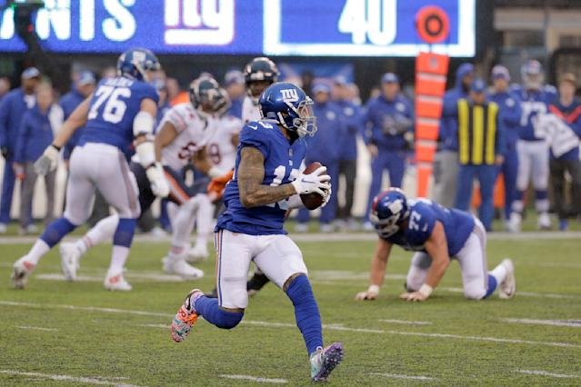 New York Giants wide receiver Odell Beckham prepares to launch a touchdown pass to wide receiver Russell Shepard, not pictured, during the second half of an NFL football game, Sunday, Dec. 2, 2018, in East Rutherford, N.J. (AP Photo/Seth Wenig)