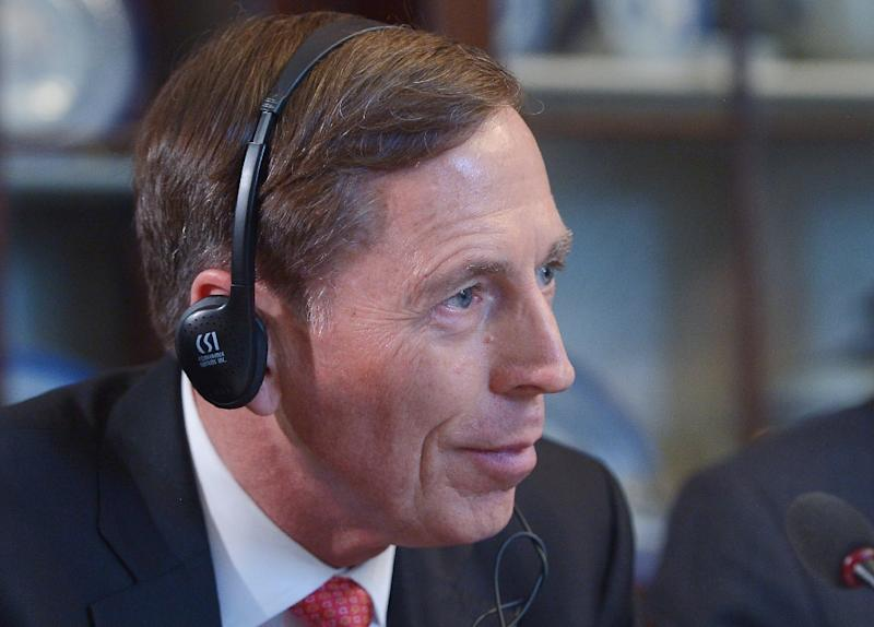 Former CIA director David Petraeus began his testimony about America's involvement in Syria with an emotional apology over his spectacular fall from grace, after he pleaded guilty this year to providing classified secrets to his mistress (AFP Photo/Mandel Ngan)