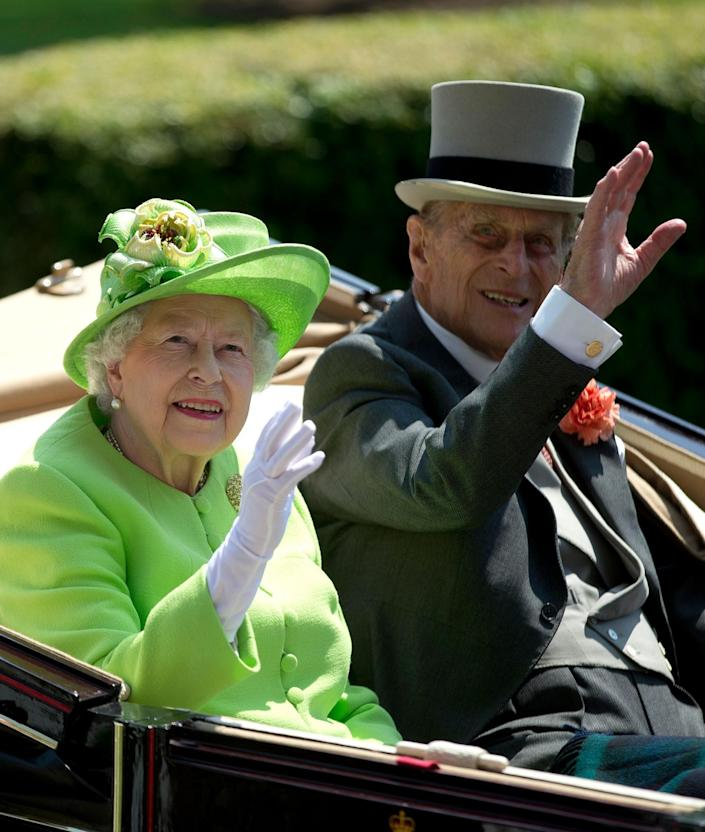 <p>Britain's Queen Elizabeth II, waves to the crowd with Prince Philip at right, as they arrive by open carriage to the parade ring on the first day of the Royal Ascot horse race meeting in Ascot, England, Tuesday, June 20, 2017. (AP Photo/Alastair Grant) </p>