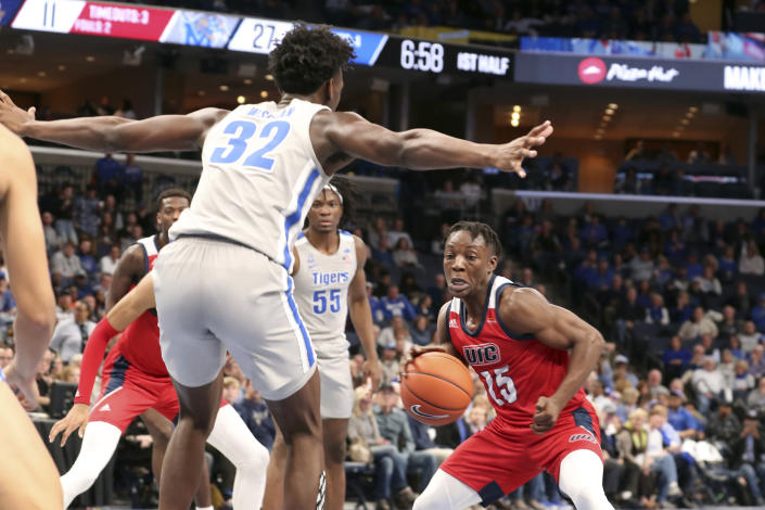 Memphis James Wiseman (32) guards Illinois-Chicago Godwin Boahen (25) during the first half of an NCAA college basketball game Friday, Nov. 8, 2019, in Memphis, Tenn. (AP Photo/Karen Pulfer Focht)