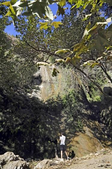 MALIBU, CA - NOVEMBER 18: Mark Mullaney, visiting from Oregon, takes a photo of the waterfall at the end of the Edward Albert Escondido Canyon Trail in Malibu on Wednesday, Nov. 18, 2020 in Malibu, CA. The trail is just short of two miles one way and ends at a waterfall when there's enough water. (Myung J. Chun / Los Angeles Times)