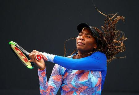 Venus Williams of the USA hits a shot during a practice session ahead of the Australian Open tennis tournament. REUTERS/David Gray