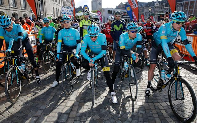 <span>Astana riders stand at the head of the field before the race started as the peloton remembered their former team-mate Michele Scarpioni who was killed while on a training ride just 24 hours earlier</span> <span>Credit: EPA </span>
