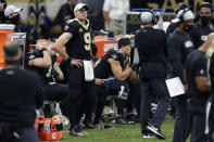 New Orleans Saints quarterback Drew Brees (9) watches from the sideline in the second half of an NFL football game against the San Francisco 49ers in New Orleans, Sunday, Nov. 15, 2020. (AP Photo/Butch Dill)