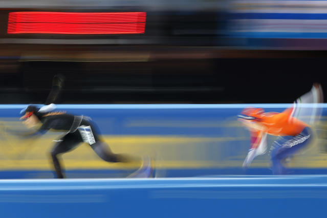 Miho Takagi of Japan, left, competes against Ireen Wust of The Netherlands, right, during the women's 1,500 meters race at the World Championships Speedskating Allround at the Olympic stadium in Amsterdam, Netherlands, Saturday, March 10, 2018. (AP Photo/Peter Dejong)