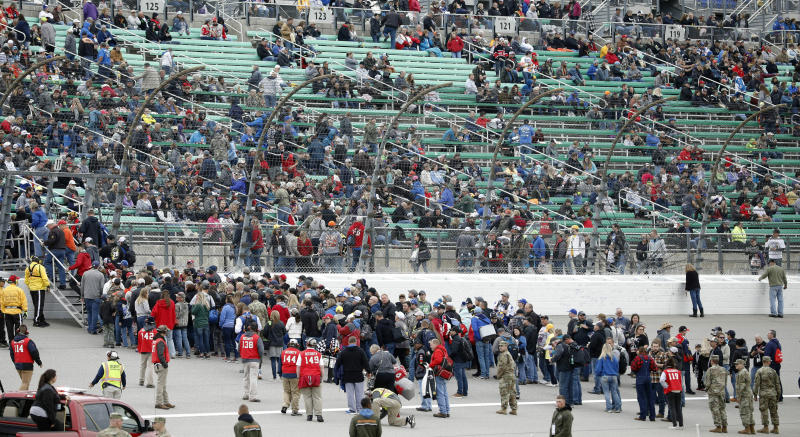Fans return to the stands following an infield concert before a NASCAR Cup Series auto race at Kansas Speedway in Kansas City, Kan., Saturday, May 11, 2019. (AP Photo/Colin E. Braley)