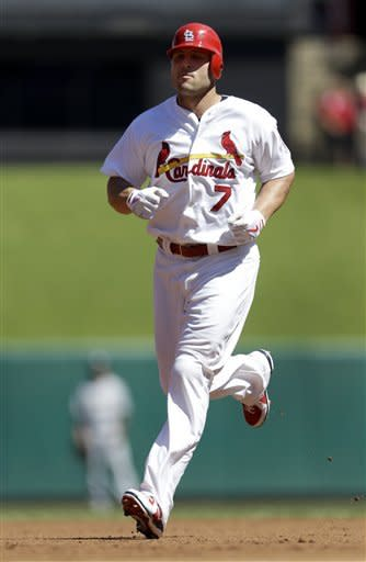 St. Louis Cardinals' Matt Holliday rounds the bases after hitting a two-run home run during the first inning of a baseball game against the Milwaukee Brewers, Sunday, Sept. 9, 2012, in St. Louis. (AP Photo/Jeff Roberson)