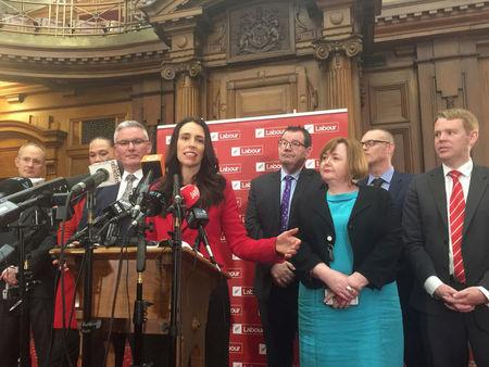 FILE PHOTO: Jacinda Ardern (C), New Zealand's new opposition Labour leader, speaks to the press alongside members of her party after Andrew Little stepped down in Wellington, New Zealand, August 1, 2017.   REUTERS/Charlotte Greenfield/File Photo