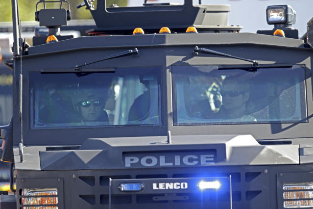 <p>An armored police vehicle arrives at Stoneman Douglas High School following a shooting at Marjory Stoneman Douglas High School in Parkland, Fla., on Feb. 14, 2018. (Photo: John McCall/South Florida Sun-Sentinel via AP) </p>