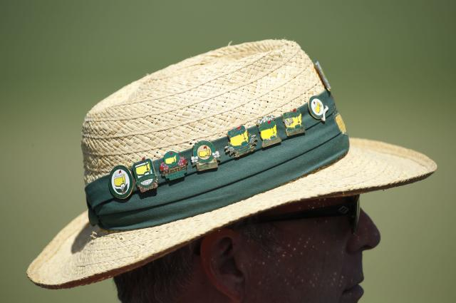 A patron wears a hat festooned with Masters pins during first round play of the 2018 Masters golf tournament at the Augusta National Golf Club in Augusta, Georgia, U.S., April 5, 2018. REUTERS/Mike Segar