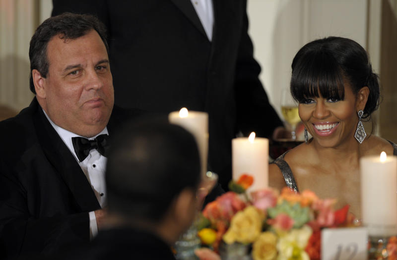 New Jersey Gov. Chris Christie sits next to first lady Michelle Obama as President Barack Obama welcomed the governors of the National Governors Association to the 2013 Governors' Dinner at the White House in Washington, Sunday, Feb. 24, 2013. (AP Photo/Susan Walsh)