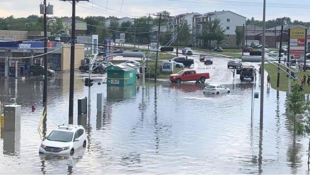 Police and firefighters were conducting rescue operations around the city Tuesday while Trois-Rivières crews worked to unblock sewers and clear debris off roadways. (Radio-Canada - image credit)