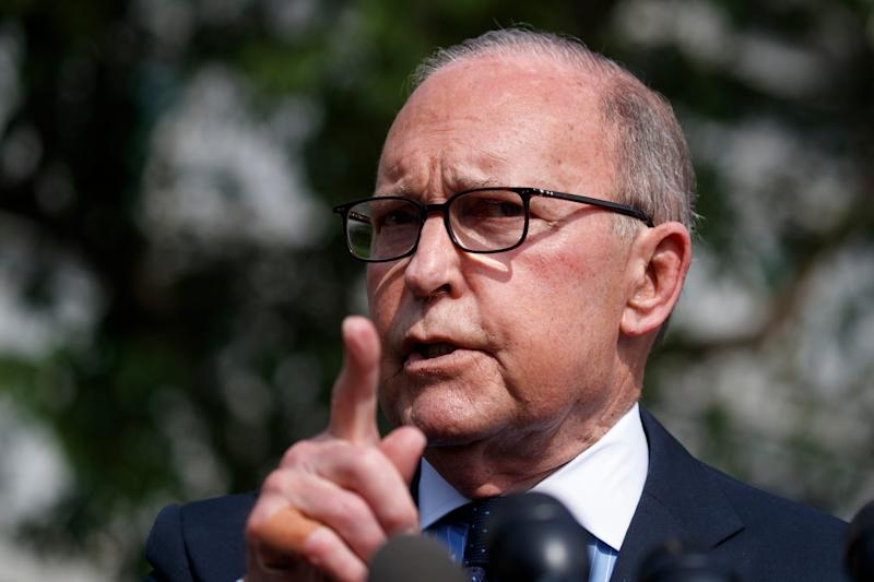 White House chief economic adviser Larry Kudlow speaks with reporters outside the White House in Washington on May 3, 2019.