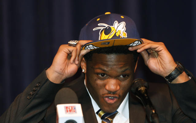 Norcross High School receiver Clinton Lynch announces that he plans to play NCAA college football at Georgia Tech during a news conference Wednesday, Feb. 5, 2014, in Norcross, Ga. (AP Photo/John Bazemore)