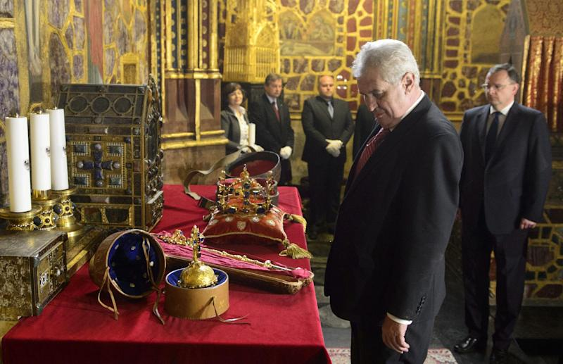 FILE In this May 9, 2013 file photo, Czech President Milos Zeman views the Czech Crown Jewels prior to their ceremonial movement for a rare showing to the public from the Crown Jewels chamber in the St. Vitus Cathedral to the Vladislav Hall at the Prague Castle. The the royal orb is seen in front. Was he or wasn't he? The video footage shows the new Czech president clearly worse for wear, propping himself up against a wall at a public event, struggling to negotiate a step and being aided by a cardinal. Milos Zeman makes no secret of his drinking. But on this occasion _ a rare and highly-ceremonial public display of the Czech crown jewels last week _ his office insisted he simply had a virus and subsequently needed a day or two of rest. (AP Photo/CTK, Michal Kamaryt) SLOVAKIA OUT