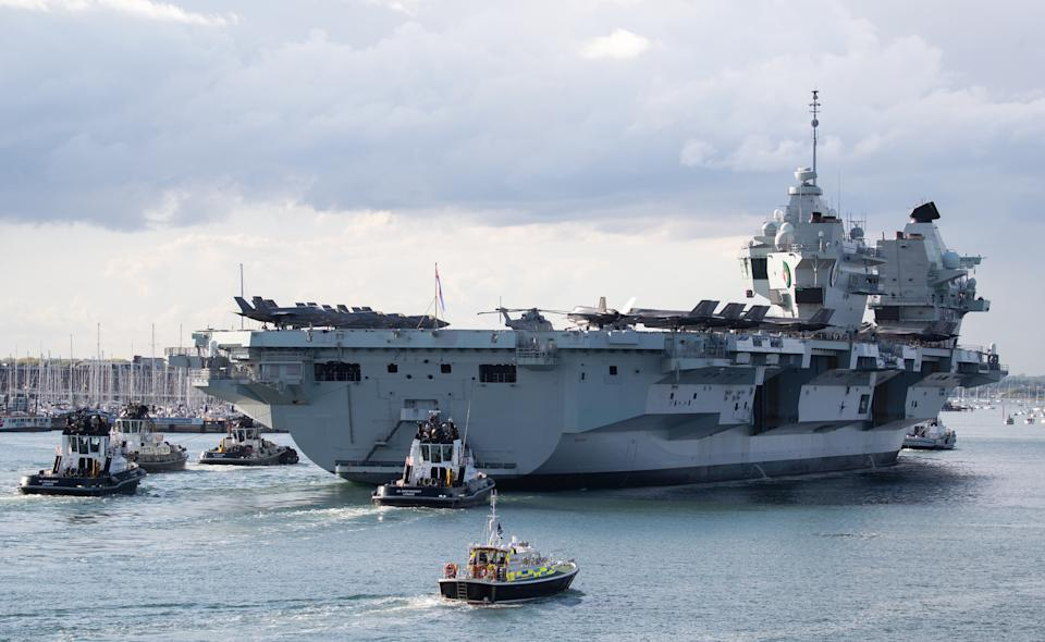 The Royal Navy aircraft carrier HMS Queen Elizabeth arrives back at Portsmouth Naval Base in Hampshire. Picture date: Wednesday May 19, 2021.