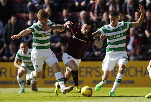 Britain Football Soccer - Heart of Midlothian v Celtic - Scottish Premiership - Tynecastle - 2/4/17 Celtic's Stuart Armstrong (L) and Celtic's Mikael Lustig in action with Heart's Jamie Walker Reuters / Russell Cheyne Livepic