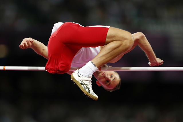 Poland's Lukasz Mamczarz competes in the men's High Jump Final F42 during the London 2012 Paralympic Games at the Olympic Stadium in London, September 3, 2012. REUTERS/Stefan Wermuth (BRITAIN - Tags: SPORT OLYMPICS ATHLETICS)
