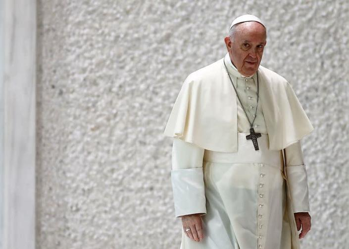 FILE PHOTO: Pope Francis arrives at the Paul VI Audience Hall at the Vatican