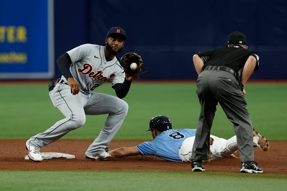 Rays second baseman Brandon Lowe slides safely into second base, beating the throw to Tigers shortstop Niko Goodrum during the third inning on Sunday, Sept. 19, 2021, in St. Petersburg, Florida.