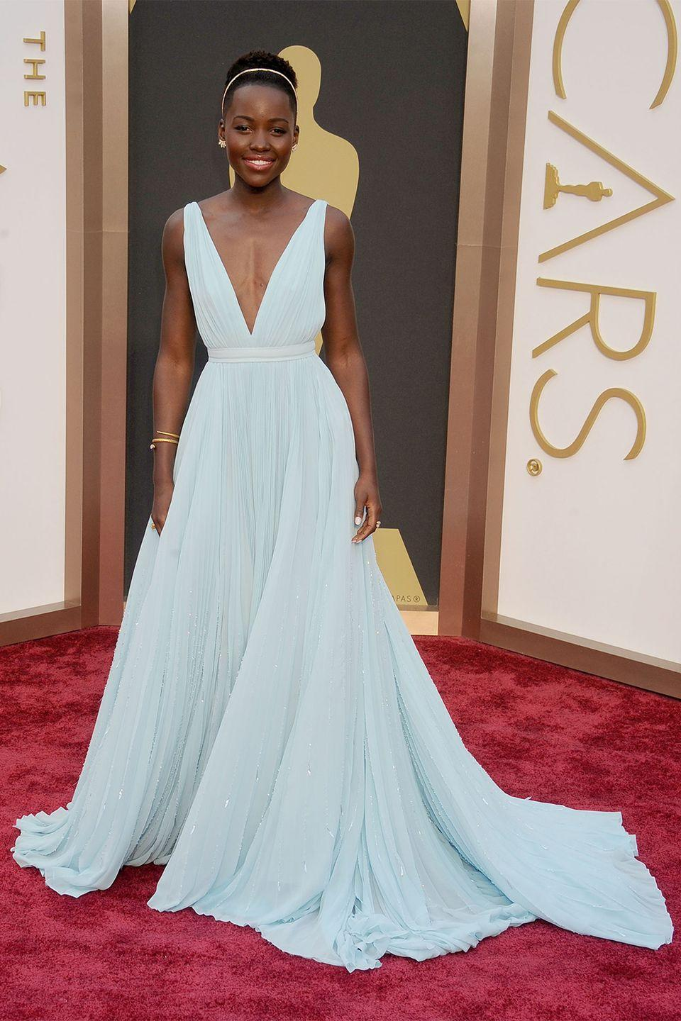 """<p>In the span of a year Lupita Nyong'o became a style icon. The actress described her custom Prada dress color as """"Nairobi blue"""" in honor of where she grew up in Kenya. </p>"""