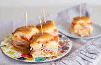 """<p>On those really hot summer days, sometimes nothing hits the spot like a cold ham-and-cheese sandwich. Whether you're going to the beach, <a href=""""https://www.thedailymeal.com/entertain/perfect-foods-every-picnic-our-40-best-recipes-slideshow?referrer=yahoo&category=beauty_food&include_utm=1&utm_medium=referral&utm_source=yahoo&utm_campaign=feed"""" rel=""""nofollow noopener"""" target=""""_blank"""" data-ylk=""""slk:planning a picnic"""" class=""""link rapid-noclick-resp"""">planning a picnic</a> or just lounging around the house, these meat-and-cheese sliders will satisfy your sandwich hankering.</p> <p><a href=""""https://www.thedailymeal.com/easy-ham-and-cheese-sliders?referrer=yahoo&category=beauty_food&include_utm=1&utm_medium=referral&utm_source=yahoo&utm_campaign=feed"""" rel=""""nofollow noopener"""" target=""""_blank"""" data-ylk=""""slk:For the Ham and Cheese Sliders recipe, click here."""" class=""""link rapid-noclick-resp"""">For the Ham and Cheese Sliders recipe, click here.</a></p>"""
