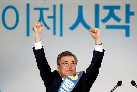 Moon Jae-in reacts after winning the nomination as a presidential candidate of the Minjoo Party, during a national convention, in Seoul