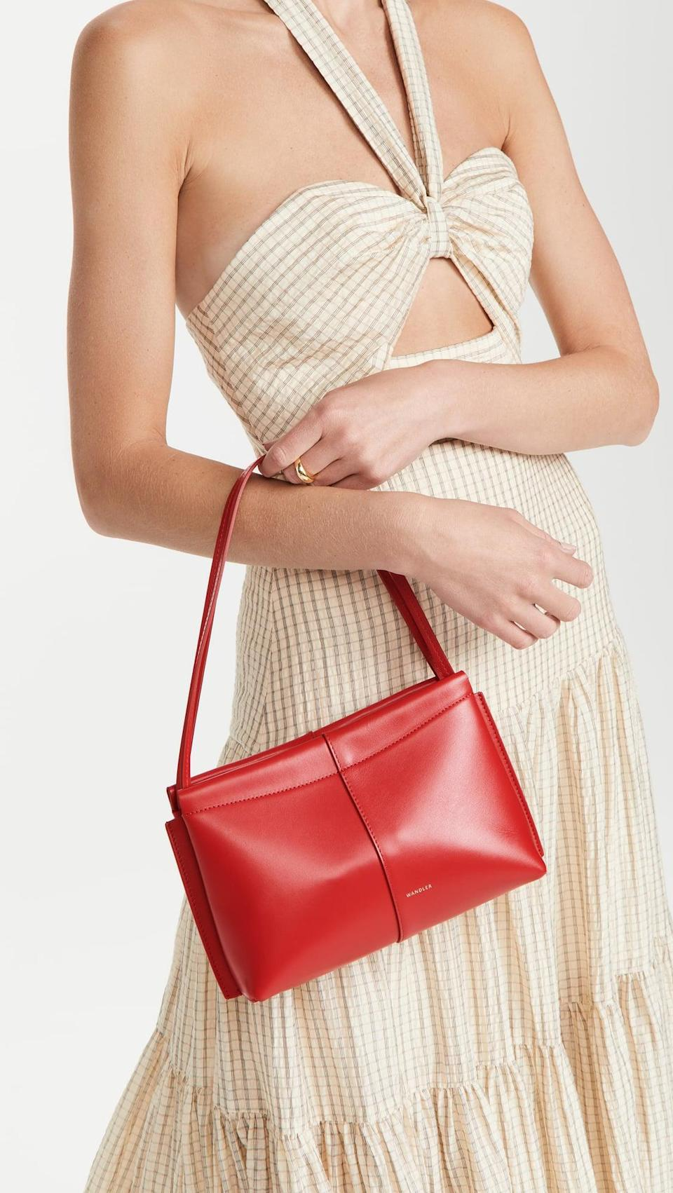 <p>We love the silhouette of this <span>Wandler Carly Mini Bag</span> ($474), but our favorite part is the color. The red really pops, and makes this simple bag stand out.</p>