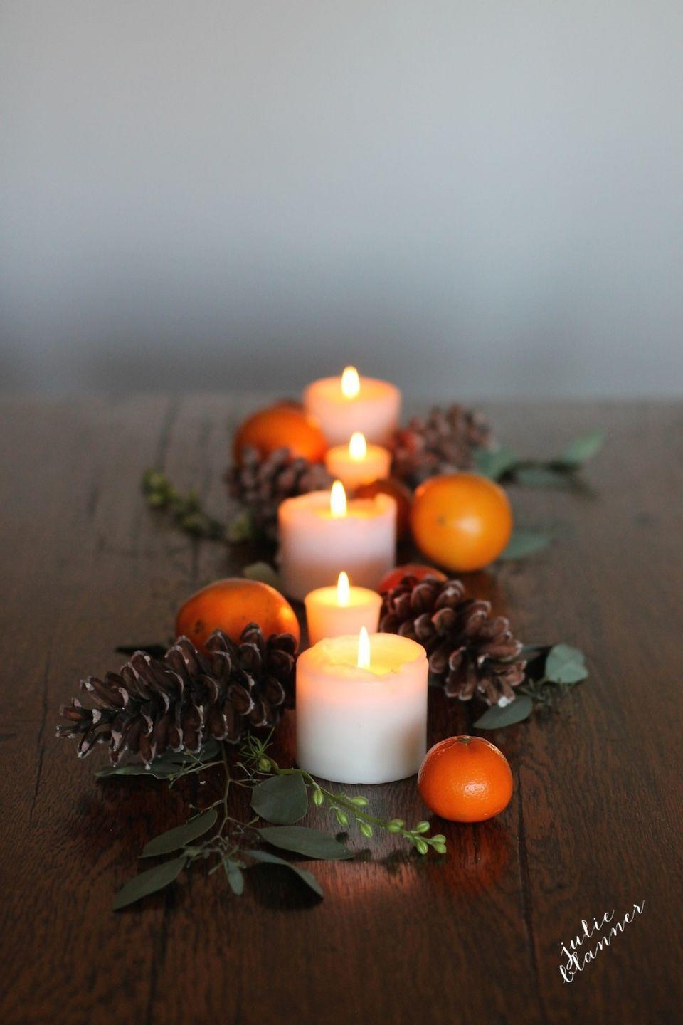 """<p>If an elaborate Thanksgiving table isn't exactly your cup of tea, take a cue from blogger Julie Blanner. In just five minutes, the blogger created a gorgeous and simple tablescape by arranging pillar candles, pinecones, clementines, and floral stems on her table.</p><p><strong>Get the tutorial at <a href=""""http://julieblanner.com/5-minute-fall-table-setting/"""" rel=""""nofollow noopener"""" target=""""_blank"""" data-ylk=""""slk:Coordinately Yours"""" class=""""link rapid-noclick-resp"""">Coordinately Yours</a>.</strong></p><p><strong><a class=""""link rapid-noclick-resp"""" href=""""https://www.amazon.com/SuperMoss-24511-Black-Spruce-8-Ounce/dp/B00K80EWGA/?tag=syn-yahoo-20&ascsubtag=%5Bartid%7C10050.g.2130%5Bsrc%7Cyahoo-us"""" rel=""""nofollow noopener"""" target=""""_blank"""" data-ylk=""""slk:SHOP PINECONES""""><strong>SHOP PINECONES</strong></a><br></strong></p>"""