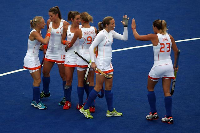 LONDON, ENGLAND - JULY 31: Ellen Hoog (3L) of the Netherlands is congratulated by team-mates after scoring their second goal during the Women's Hockey Match between the Netherlands and Japan on day 4 of the London 2012 Olympic Games at Hockey Centre on July 31, 2012 in London, England. (Photo by Daniel Berehulak/Getty Images)
