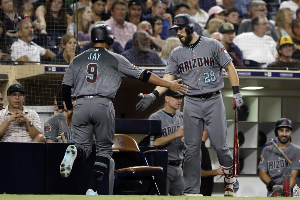 Arizona Diamondbacks' Jon Jay (9) is greeted by Steven Souza Jr. after scoring during the fourth inning of a baseball game against the San Diego Padres on Friday, Aug. 17, 2018, in San Diego. (AP Photo/Gregory Bull)