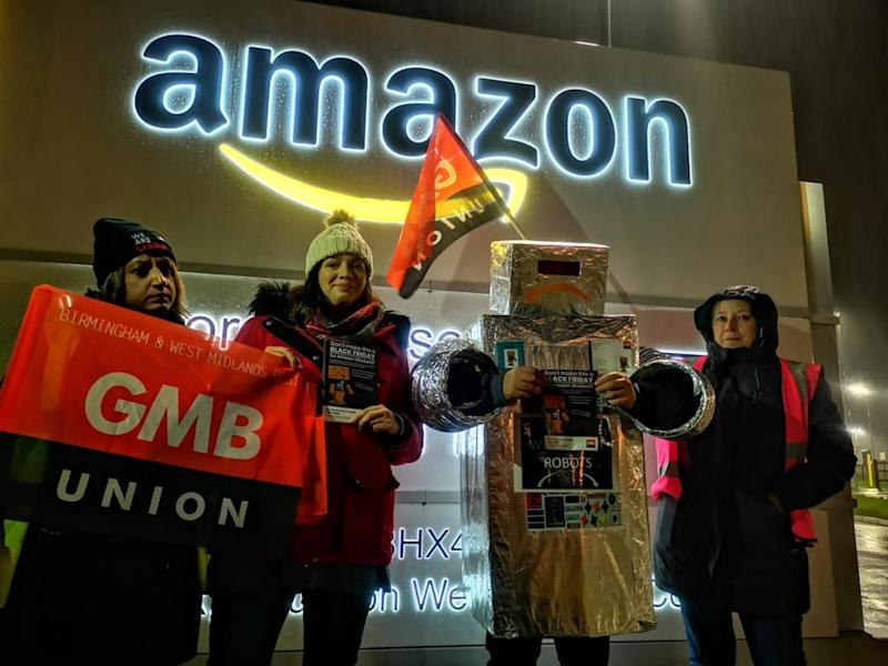 Workers striking outside an Amazon warehouse. Photo: GMB