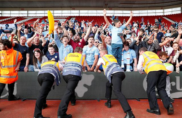 "Soccer Football - Premier League - Southampton vs Manchester City - St Mary's Stadium, Southampton, Britain - May 13, 2018 Manchester City's fans celebrate after the match Action Images via Reuters/John Sibley EDITORIAL USE ONLY. No use with unauthorized audio, video, data, fixture lists, club/league logos or ""live"" services. Online in-match use limited to 75 images, no video emulation. No use in betting, games or single club/league/player publications. Please contact your account representative for further details."