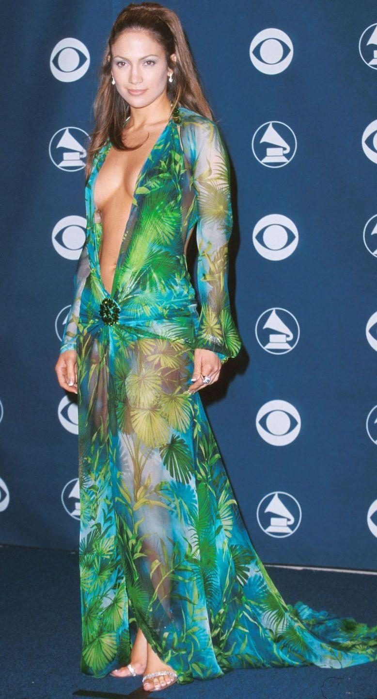 """<p>Admit it, you've been waiting for J.Lo's <a href=""""https://www.cosmopolitan.com/uk/fashion/celebrity/g35246043/celebrities-outfit-repeat/"""" rel=""""nofollow noopener"""" target=""""_blank"""" data-ylk=""""slk:famous Versace jungle"""" class=""""link rapid-noclick-resp"""">famous Versace jungle</a> <a href=""""https://www.cosmopolitan.com/uk/fashion/celebrity/g10355575/jennifer-lopez-naked/"""" rel=""""nofollow noopener"""" target=""""_blank"""" data-ylk=""""slk:naked dress"""" class=""""link rapid-noclick-resp"""">naked dress</a>, worn to the 2000 Grammy Awards.</p>"""