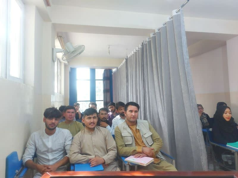 Students attend class under new classroom conditions at Avicenna University in Kabul