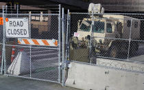 National Guard troops maintain the fenced-off road leading to the Hennepin County Government Center, Monday, March 8, 2021, in Minneapolis where the trial for former Minneapolis police officer Derek Chauvin began with jury selection. Chauvin is charged with murder in the death of George Floyd during an arrest last May in Minneapolis. (AP Photo/Jim Mone)