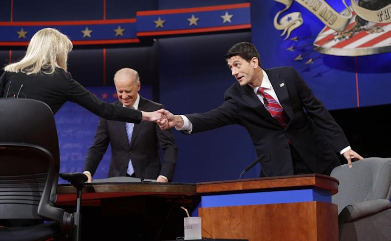 Moderator Martha Raddatz, left, reaches across to greet Republican vice presidential candidate, Rep. Paul Ryan, R-Wis., right, as Vice President Joe Biden, center, takes his seat for the start of the vice presidential debate, at Centre College in Danville, Ky., Thursday, Oct. 11, 2012. (AP Photo/Pablo Martinez Monsivais)