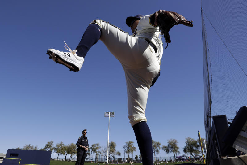 Milwaukee Brewers right fielder Avisail Garcia stretches before a spring training baseball game against the Seattle Mariners, Tuesday, Feb. 25, 2020, in Phoenix. (AP Photo/Gregory Bull)