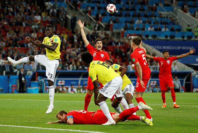 <p>PENALTY! Colombia's Carlos Sanchez concedes a penalty for hauling Harry Kane to the ground in the box </p>