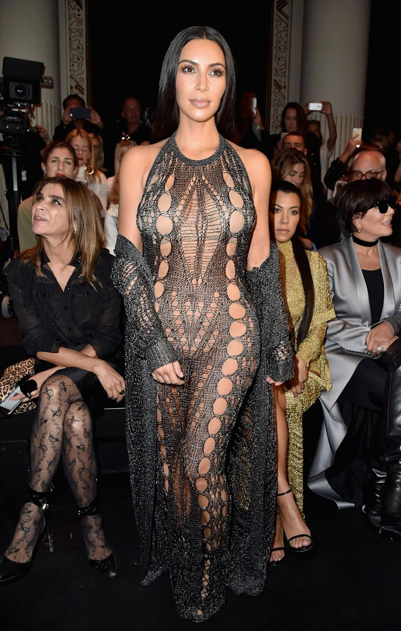 Kim Kardashian wore a racy, barely-there gown when she attended the Balmain show during Paris Fashion Week in September in Paris. (Photo: Getty Images)