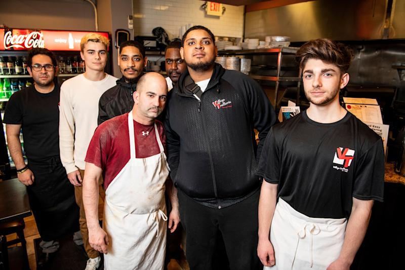 Quinn Butler, second from left, Edward Roman, third from left, and Edwin Roman, sixth from left, with their coworkers at the Village Trattoria in Summit, New Jersey. (Photo: Damon Dahlen/HuffPost)