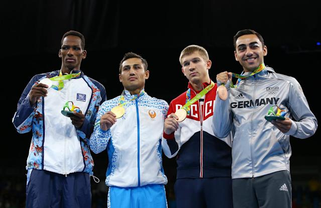 2016 Rio Olympics - Boxing - Victory Ceremony - Men's Light Welter (64kg) Victory Ceremony - Riocentro - Pavilion 6 - Rio de Janeiro, Brazil - 21/08/2016. (From L) Silver medallist Collazo Sotomayor (AZE) of Azerbaijan, gold medallist Fazliddin Gaibnazarov (UZB) of Uzbekistan, and bronze medallists Vitaly Dunaytsev (RUS) of Russia and Artem Harutyunyan (GER) of Germany pose with their medals. REUTERS/Peter Cziborra FOR EDITORIAL USE ONLY. NOT FOR SALE FOR MARKETING OR ADVERTISING CAMPAIGNS.