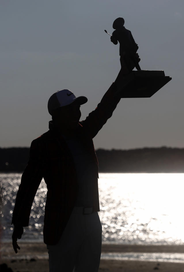 C.T. Pan holds his trophy in the air after winning the RBC Heritage golf tournament at Harbour Town Golf Links on Hilton Head Island, S.C., Sunday, April 21, 2019. Pan won with a 12-under par for his first PGA victory. (AP Photo/Mic Smith)