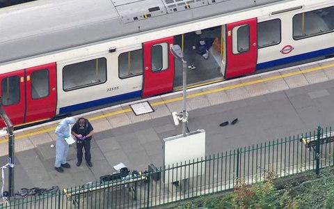 forensic officers work at the Parsons Green Underground Station after an explosion - Credit: PA