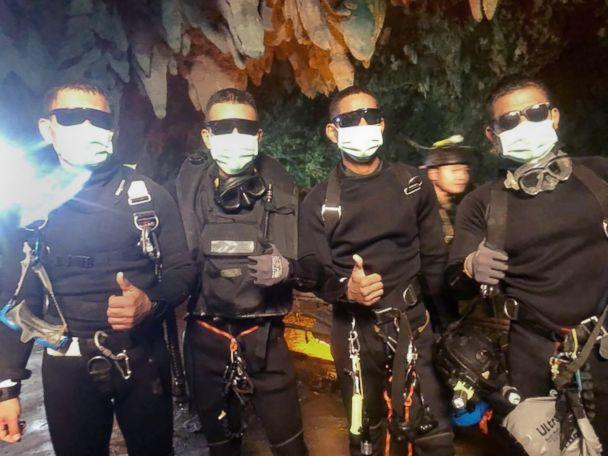 PHOTO: The three Royal Thai Navy SEAL divers and medics who stayed in the cave with the boys and coach since they were located on July 2. Officials said they emerged from the cave 'healthy' shortly after the last rescues were made, July 10, 2018. (Royal Thai Navy SEALs)