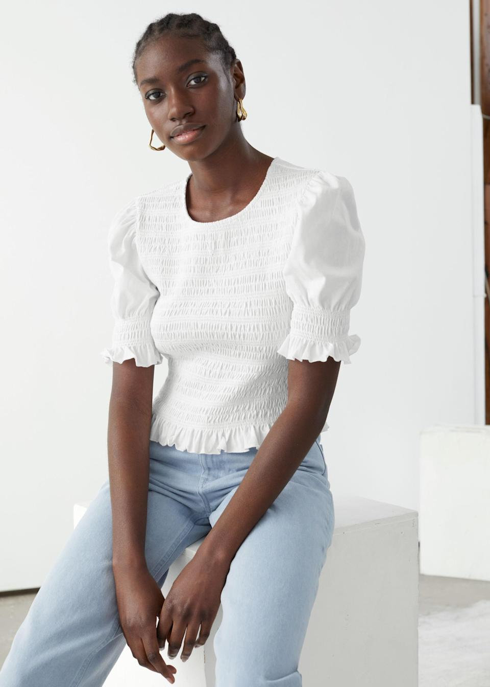 """$49, & Other Stories. <a href=""""https://www.stories.com/en_usd/clothing/tops/tops-t-shirts/product.smocked-puff-sleeve-crop-top-white.0864694004.html"""" rel=""""nofollow noopener"""" target=""""_blank"""" data-ylk=""""slk:Get it now!"""" class=""""link rapid-noclick-resp"""">Get it now!</a>"""