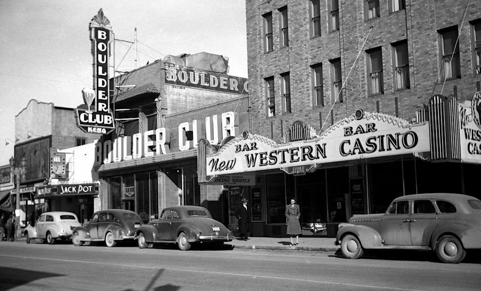 "<p>A woman poses under the marquee at the Western Casino, which stayed in business from 1942–1944 on Fremont Street. Today, Fremont Street is known as ""old Vegas"" and is located just north of the Vegas Strip. It was the first paved street in the city.</p>"