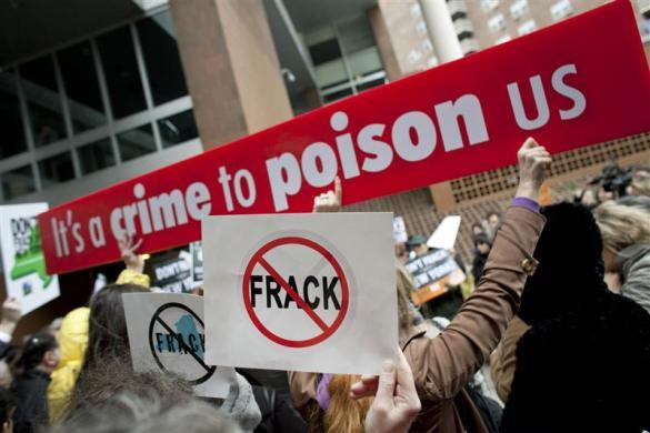 People protest against hydraulic fracturing outside the Tribeca Performing Arts Center, Borough of Manhattan Community College in New York November 30, 2011.